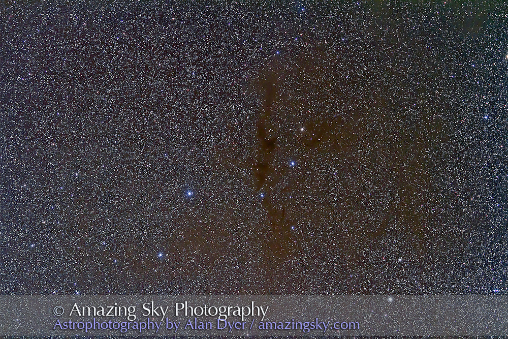 B228 the Dark Wolf Nebula in Lupus. This is a stack of six 2-minute exposures with the 135mm L-series Canon telephoto lens at f/2.8 and Canon 7D at ISO 1250. This was taken from Atacama Lodge in Chile, May 2011. The field of view simulates a binocular field (roughly 7°).