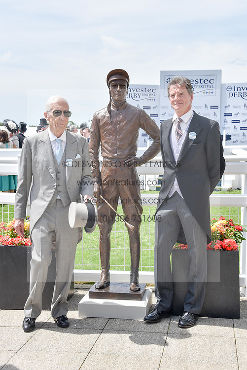 Sir Lester Piggott and artist Willie Newton with a statue of Lester Piggott at the 2d day of The Investec Derby Festival - Derby Day, Epsom Racecourse, Epsom, Surrey, UK. 01 June 2019.