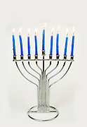 Silver Hannukah Menorah with blue candles on white background