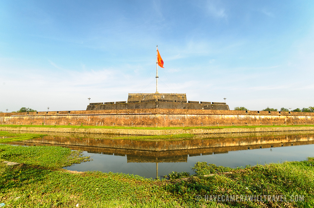 The moat around the Imperial City in Hue, Vietnam. A self-enclosed and fortified palace, the complex includes the Purple Forbidden City, which was the inner sanctum of the imperial household, as well as temples, courtyards, gardens, and other buildings. Much of the Imperial City was damaged or destroyed during the Vietnam War. It is now designated as a UNESCO World Heritage site.