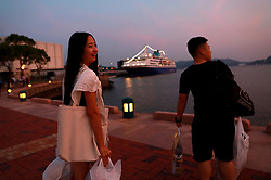 Transgender couple Chen Zhichao (R), and partner Yang Jieli (L) returns to the cruise ship with bags of shopping during a stopover of a cruise organised by the Parents and Friends of Lesbians and Gays (PFLAG) China organisation at Sasebo, Nagasaki, Japan, 16 June 2017. About 800 members of the Chinese LGBT (lesbian, gay, bisexual and transgender) community and their parents spent four days on a cruise trip organised by Parents and Friends of Lesbians and Gays (PFLAG) China, a grassroots non-government organisation, celebrating the 10th anniversary of the organisation. It aims to promote coexistence among homosexuals and their families.