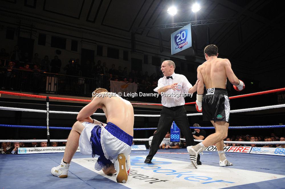 John Ryder knocks down Luke Osman in a 6x3min Middleweight contest at York Hall 09.11.11. Matchroom Sport. Photo credit: © Leigh Dawney 2011.