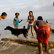 Veracruz Beach, Panama..Young people have fun on a summer afternoon in Veracruz Beach, a small beach and fisher community some 10 miles west out side Panama City, Panama, near the Pacific Ocean entrance to the Panama Canal.