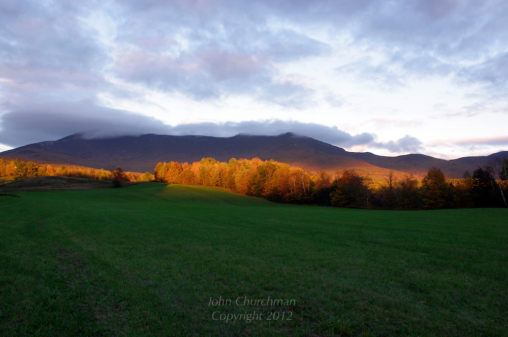 Last light on Mt. Mansfield, Vermont under dark clouds