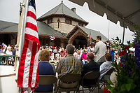 Mayor Ed Engler welcomes the crowd to the 125th anniversary celebration of the Laconia Train Station on Saturday morning.  (Karen Bobotas/for the Laconia Daily Sun)