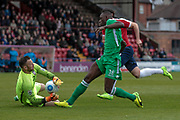 Ntumba Massanka (on loan from Burnley) (Wrexham AFC) challenges Scott Loach (York City) for the ball during the Vanarama National League match between York City and Wrexham FC at Bootham Crescent, York, England on 17 April 2017. Photo by Mark P Doherty.