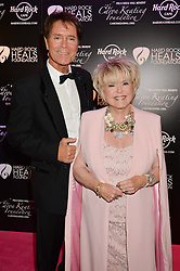 SIR CLIFF RICHARD and GLORIA HUNNIFORD at the annual PINKTOBER Gala presented by Hard Rock Heals at The Dorchester, Park Lane, London on 14th October 2016.  The annual event raises money for The Caron Keating Foundation.
