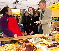 Pictured: Willie Rennie, Hannah Betsworth chatted with and sampled the wares of Nadrina Tucker at the Sweet Temptations stall<br /> <br /> Liberal Democrat leader Willie Rennie and  Hannah Bettsworth, Liberal Democrat candidate for Edinburgh Central and the Lothian regional list, headed to Stockbridge today to meet Easter shoppers and stallholders at the Sunday farmers market. <br /> <br /> Ger Harley | EEm 27 March 2016