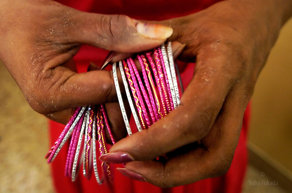 A transgender puts on bangles in Villupuram, India. <br />