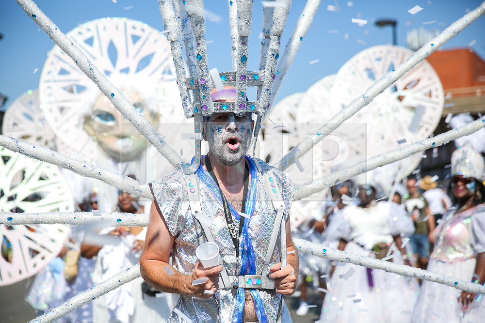 © Licensed to London News Pictures. 26/08/2019. London, UK. A dancer parade on the second day of Notting Hill Carnival in west London. Thousands of revellers take part in Notting Hill Carnival, Europe's largest street party and a celebration of Caribbean traditions and the capital's cultural diversity. Photo credit: Dinendra Haria/LNP
