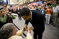 Sen. Barack Obama (D-IL) greets June Whitcomb of Kingston, N.H., at a campaign rally in Exeter, N.H., on Sunday, Jan. 6, 2008.