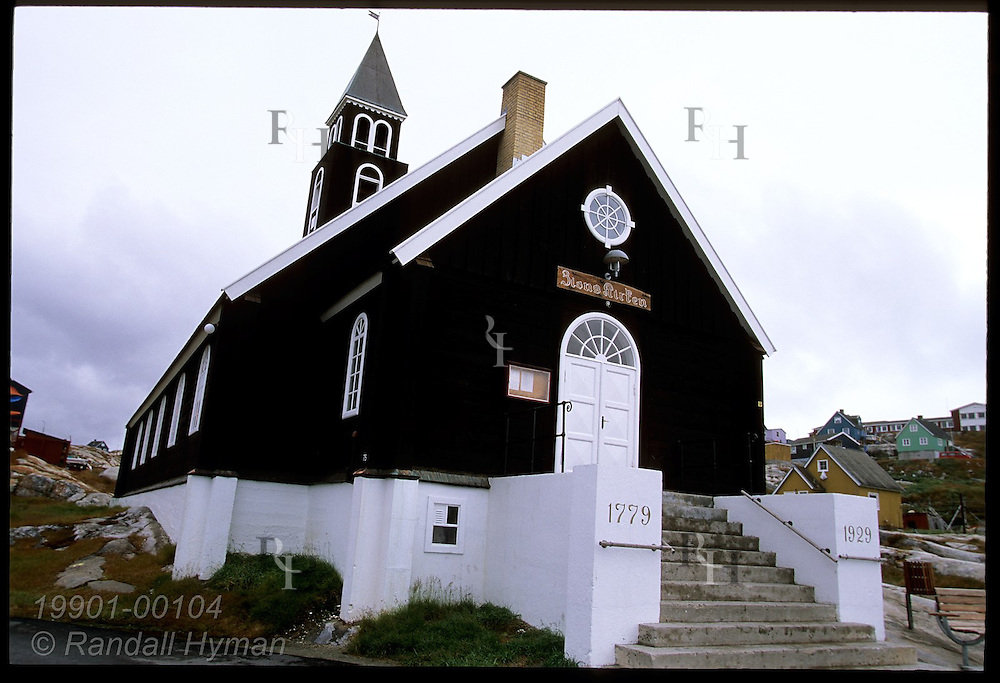 Zion's Church (1779), vestige of early Danish colonial era, sits on rocky hillside above Disko Bay in the town of Ilulissat, Greenland.