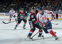KELOWNA, CANADA - OCTOBER 16: Macoy Erkamps #6 of the Lethbridge Hurricanes handles the puck while being checked by Joe Gatenby #28 of the Kelowna Rockets on October 16, 2013 at Prospera Place in Kelowna, British Columbia, Canada.   (Photo by Marissa Baecker/Shoot the Breeze)  ***  Local Caption  ***