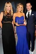Uitreiking Grazia Red Carpet Awards in the Grand, Amsterdam.<br /> <br /> Op de foto:  Yolanthe Sneijder-Cabau krijgt de Red Carpet Style Goddess Award uit handen van  Valerio Zeno en Hilmar Mulder
