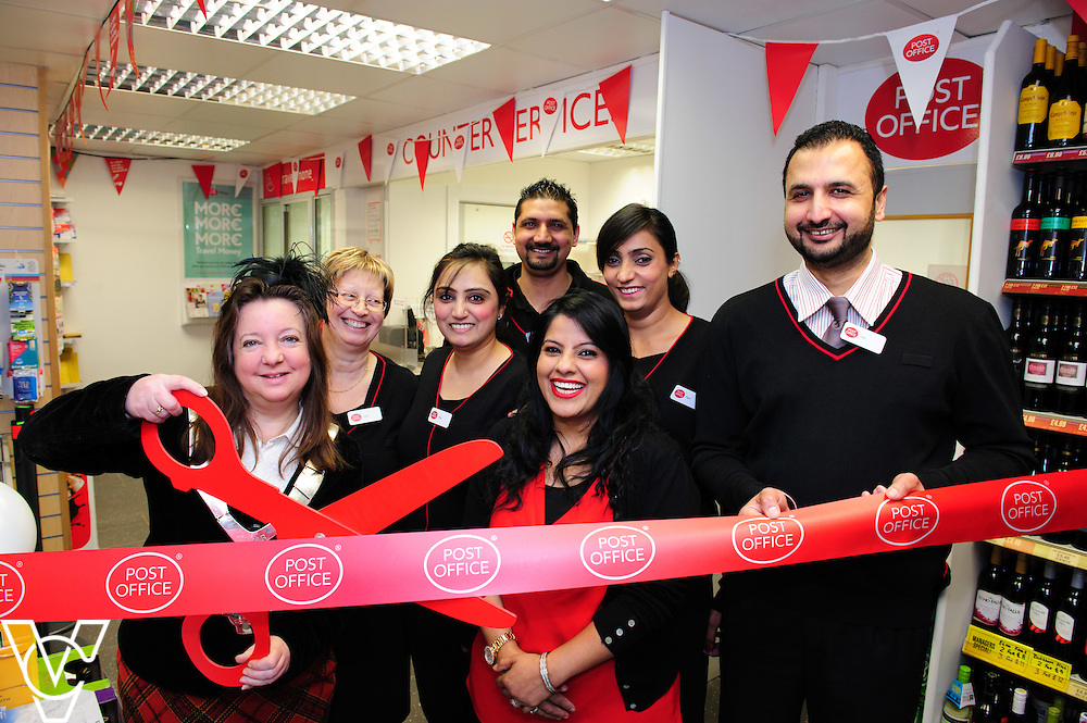Pictured is Jeanne Douglas, Mayor of Melton, left, cutting the ribbon to open Melton Mowbray Post Office.  Also pictured is, from left, Julie Key, Mandeep Kavr, Parmjit Singh, Mandy Kavr, Parmjit Kavr and postmaster Amarjit Singh.<br /> <br /> The Mayor of Melton Jeanne Douglas has officially opened the new Post Office in Melton Mowbray.<br /> <br /> Date: March 16, 2016