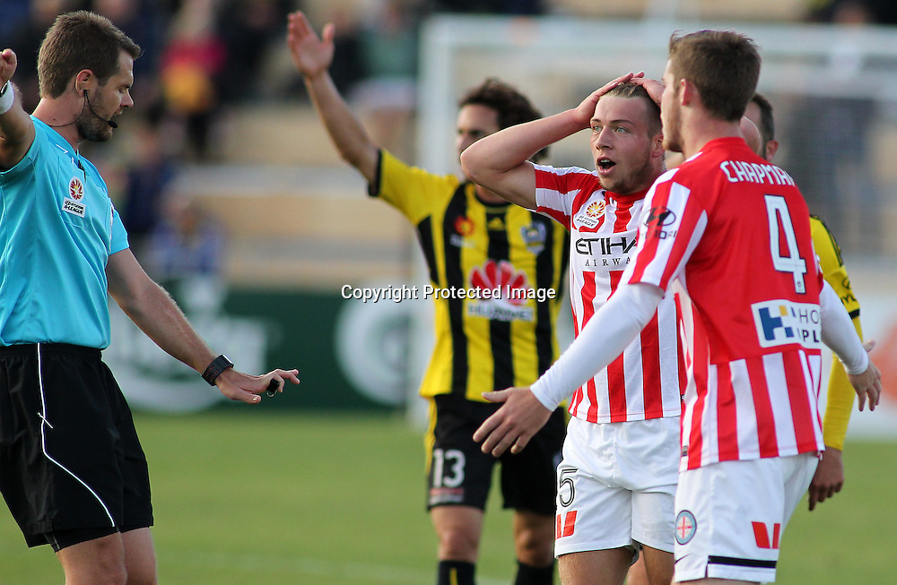 Melbournes' Jacob Melling disagrees with a referees call during the A-League football match between the Wellington Phoenix & Melbourne City, at the Hutt Recreational Ground, Wellington, 14 February 2015. Photo.: Grant Down / www.photosport.co.nz