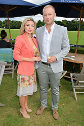 Rugby player SHANE GERAGHTY and OCTAVIA ST.JOHN at the Laureus King Power Cup polo match held at Ham Polo Club, Richmond on 16th June 2016.