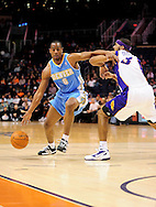 Dec. 22, 2011; Phoenix, AZ, USA; Denver Nuggets shooting guard Arron Afflalo (6) handles the ball against Phoenix Suns small forward Jared Dudley (3) during a preseason game at the US Airways Center. Mandatory Credit: Jennifer Stewart-US PRESSWIRE.