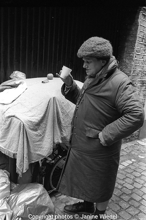 Homeless woman living under prams in Knightsbridge London 1970s