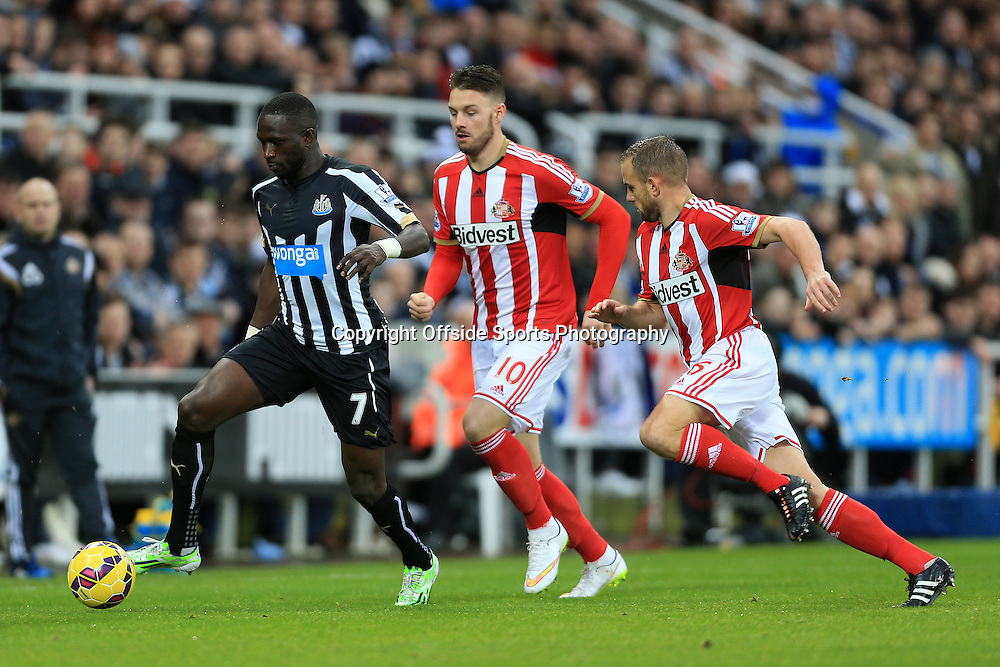 21st December 2014 - Barclays Premier League - Newcastle United v Sunderland - Moussa Sissoko of Newcastle gets away from Connor Wickham of Sunderland (C) and Lee Cattermole of Sunderland (R) - Photo: Simon Stacpoole / Offside.