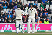 50 - Mitchell Starc of Australia celebrates scoring a half century with Nathan Lyon of Australia congratulating him during the International Test Match 2019, fourth test, day two match between England and Australia at Old Trafford, Manchester, England on 5 September 2019.