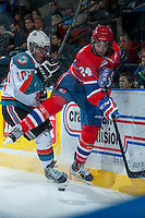 KELOWNA, CANADA -JANUARY 29: Nick Merkley #10 of the Kelowna Rockets checks Cole Wedman D #24 of the Spokane Chiefs at the boards during the third period on January 29, 2014 at Prospera Place in Kelowna, British Columbia, Canada.   (Photo by Marissa Baecker/Getty Images)  *** Local Caption *** Nick Merkley; Cole Wedman;