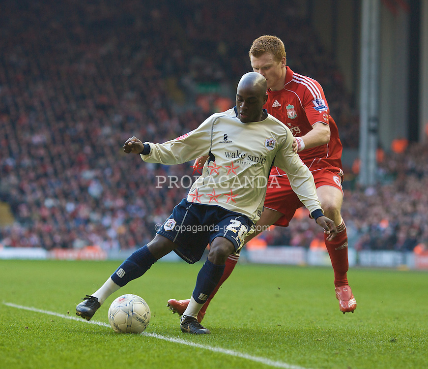 LIVERPOOL, ENGLAND - Saturday, February 16, 2008: Liverpool's John Arne Riise and Barnsley's Jamal Campbell-Ryce during the FA Cup 5th Round match at Anfield. (Photo by David Rawcliffe/Propaganda)