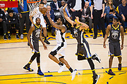 San Antonio Spurs forward LaMarcus Aldridge (12) beats Golden State Warriors center JaVale McGee (1) to the basket during Game 2 of the Western Conference Quarterfinals at Oracle Arena in Oakland, Calif., on April 16, 2018. (Stan Olszewski/Special to S.F. Examiner)