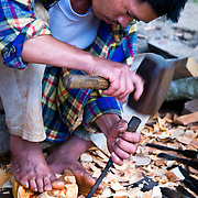 PHILIPPINES (Bocos, Banaue. Province of Ifugao). 2009. A man carving wood in the village of Bocos, near Banaue.