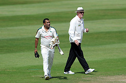 Nottinghamshire's Samit Patel exchanges views with Umpire Steve Garrett after a decision went against him. - Photo mandatory by-line: Harry Trump/JMP - Mobile: 07966 386802 - 16/06/15 - SPORT - CRICKET - LVCC County Championship - Division One - Day Three - Somerset v Nottinghamshire - The County Ground, Taunton, England.