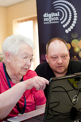 Digital Region Co-Running a series of workshops to equip the elderly with basic computer skills at Bakersfield Court sheltered housing on Longfellow Drive Rotherham - Joan Stagg with Jon Mayo Director of JMLB Genisis..21 March 2011.Images © Paul David Drabble