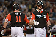 PHOENIX, AZ - AUGUST 26:  A.J. Pollock #11 of the Arizona Diamondbacks wearing a nickname-bearing jersey is congratulated by Paul Goldschmidt #44 after hitting solo home run in the first inning against the San Francisco Giants at Chase Field on August 26, 2017 in Phoenix, Arizona.  (Photo by Jennifer Stewart/Getty Images)