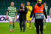 Brendan Rogers, manager of Celtic FC speaks with his captain, Scott Brown (#8) of Celtic FC after the final whistle of the Europa League round 32 match between Celtic FC and Valencia CF at Celtic Park, Glasgow, Scotland on 14 February 2019.