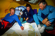Inside dome tent while plotting progress across Greenland icecap, dog sledging expdition.
