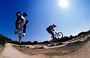BMXers, Ian Gunner, Toby Forte, doing jumps, getting air, UK 2000's