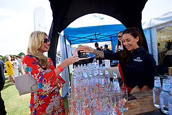 LIVERPOOL, ENGLAND - Saturday, June 23, 2018: Corporate guests enjoy a complimentary Liverpool Gin with Lamb & Watt Tonic water outside the hospitality tent during day three of the Williams BMW Liverpool International Tennis Tournament 2018 at Aigburth Cricket Club. (Pic by Paul Greenwood/Propaganda)