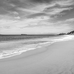 Maui Hawaii Makena Big Beach black and white photo. Big Beach is in Wailea-Makena Kihei Hawaii and is one of Maui's most popular beaches. Copyright ⓒ 2019 Paul Velgos with All Rights Reserved.