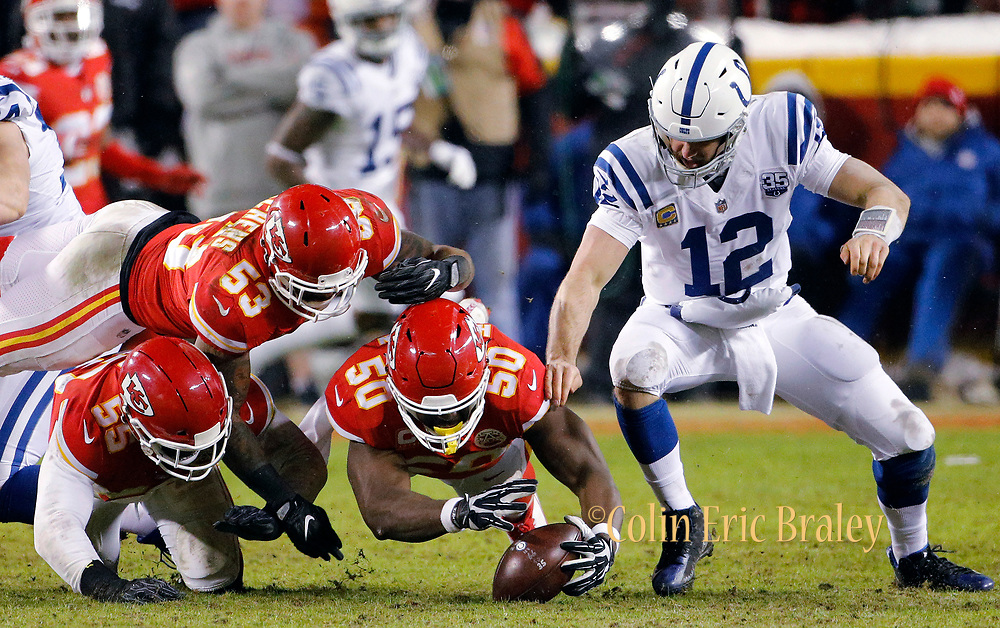 Kansas City Chiefs linebackers Anthony Hitchens (53) Dee Ford (55) and Justin Houston (50) go after a fumble by Indianapolis Colts quarterback Andrew Luck (12) during an AFC divisional NFL football game at Arrowhead Stadium in Kansas City, Mo., Saturday, Jan. 12, 2019. Ford stripped the ball away from Luck, ending a Colts' drive in Chiefs territory.  (AP Photo/Colin E. Braley)