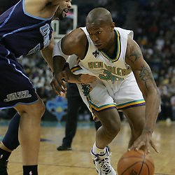 New Orleans Hornets forward David West #30 drives past Carlos Boozer #5 in the first quarter of their NBA game on April 8, 2008 at the New Orleans Arena in New Orleans, Louisiana.
