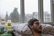 Muhamed Tahar, 21 years, member of Al-Tawhid Brigade, wounded by a self made bomb that exploded in his hand in November 2013 in Aleppo. He is now treated in a improvised hospital in Kilis, Turkey. His spinal cord is shattered, he can not use his legs anymore. He deserted from the Syrian army where he was serving at the military academy, because the army is corrupt he says. He fought one and a half years in the FSA ranks.<br /> <br /> <br /> Muhamed Tahar, 21 ans, blessé par une bombe artisanale qui a explosé dans sa main en novembre 2013 à Alep, il est soigné dans un hôpital improvisé à Kilis, Turquie. Sa colonne vertébrale est brisée. Il est un membre du Brigade Al-Tawhid, il ne peut plus utiliser ses jambes. Il a déserté de l'armée de Bachar al Assad, parce qu'il trouvait que l'armée syrienne est corrompue.  Ensuite il a combattu pendant 18 mois dans le Brigade Al-Tawhid.
