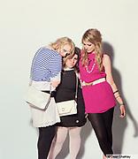 Three Mod / Indie girls posing together, wearing Retro, vintage clothing, Southend, UK 2006