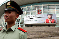 POLICE OFFICER BEFORE SPECIAL OLYMPICS WORLD SUMMER GAMES SHANGHAI 2007..SPECIAL OLYMPICS IS AN INTERNATIONAL ORGANIZATION DEDICATED TO EMPOWERING INDIVIDUALS WITH INTELLECTUAL DISABILITIES..SHANGHAI , CHINA , SEPTEMBER 30, 2007.( PHOTO BY ADAM NURKIEWICZ / MEDIASPORT )..