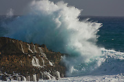 Giant winter surf batters Oahu's shore at Laie Point, Hawaii