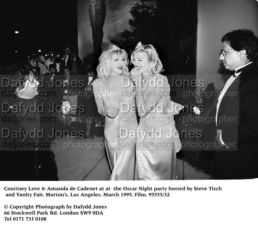 Courtney Love &amp; Amanda de Cadenet at at  the Oscar Night party hosted by Steve Tisch and Vanity Fair. Morton's. Los Angeles. March 1995. Film. 95555/32<br /> &copy; Copyright Photograph by Dafydd Jones<br /> 66 Stockwell Park Rd. London SW9 0DA<br /> Tel 0171 733 0108