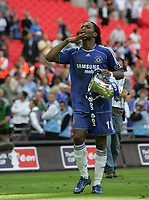 Photo: Lee Earle.<br /> Chelsea v Manchester United. The FA Cup Final. 19/05/2007.Chelsea's Didier Drogba celebrates at the end.
