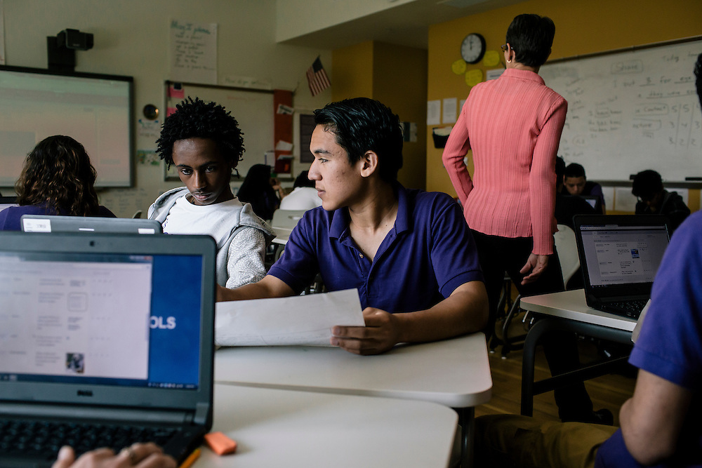 Students in Washington D.C.'s first-year International Academy for English-language learners, including Berhanu Demissie, left, of Ethiopia, and Omar Joya, 18, right of El Salvador, work on a practice quiz during English class at the International Academy at Cardozo Education Campus on April 22, 2015. The program is aimed at dealing with the influx of unaccompanied minors, mostly teenage males from Central American countries, and allows them to be in classes of 25 together. Currently Cardozo, in NW Washington D.C. has about 200 of these students.