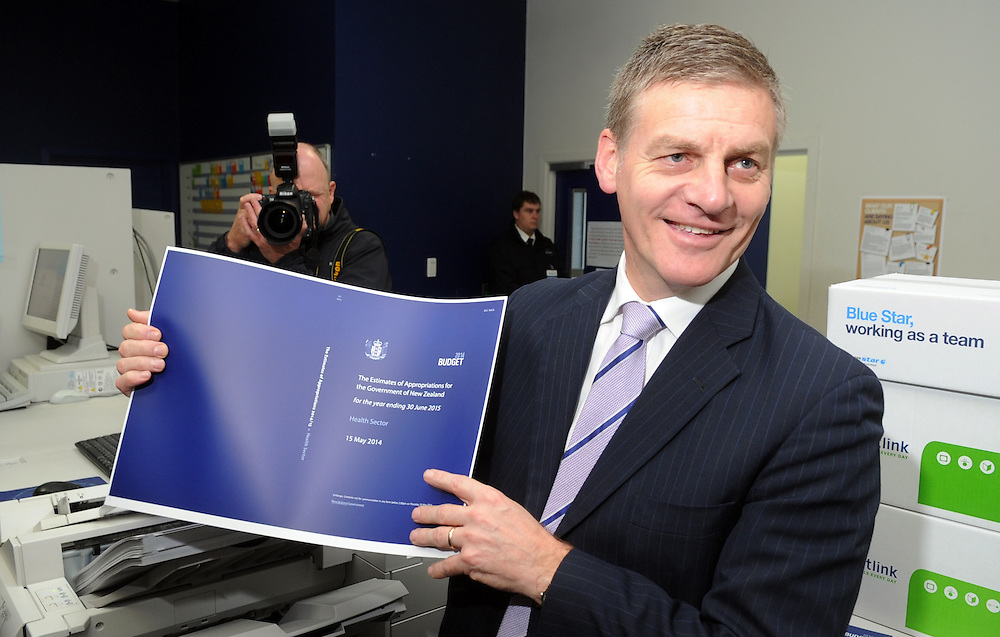 Finance Minister Bill English with a copy of the 2014 Budget, his sixth, at the printers, Petone, New Zealand, Wednesday, May 14, 2014. Credit:SNPA / Ross Setford