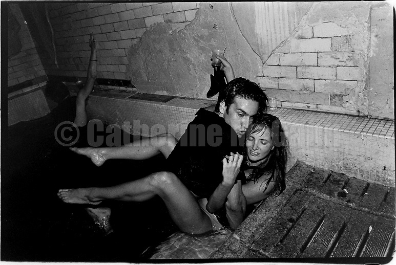 July 18, 1989:  A couple in the pool in the basement of night club Cave Canem, about 5:00 am on July 18, 1989 in New York City, New York.