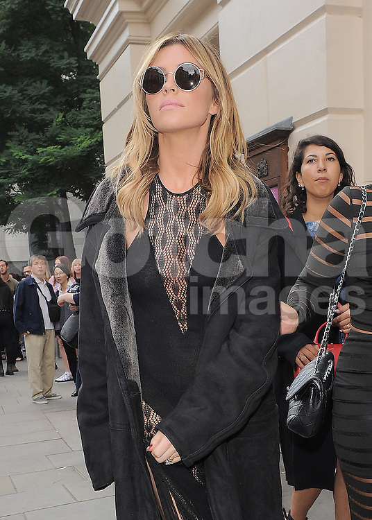 Model Abbey Clancy attends the Julien Macdonald catwalk show during London Fashion Week Spring Summer 2015 in London, UK. 13/09/2014<br /> BYLINE MUST READ : GOTCHAIMAGES.COM<br /> <br /> Copyright by &copy; Gotcha Images Ltd. All rights reserved.<br /> Usage of this image is conditional upon the acceptance <br /> of Gotcha Images Ltd, terms and conditions available at<br /> www.gotchaimages.com