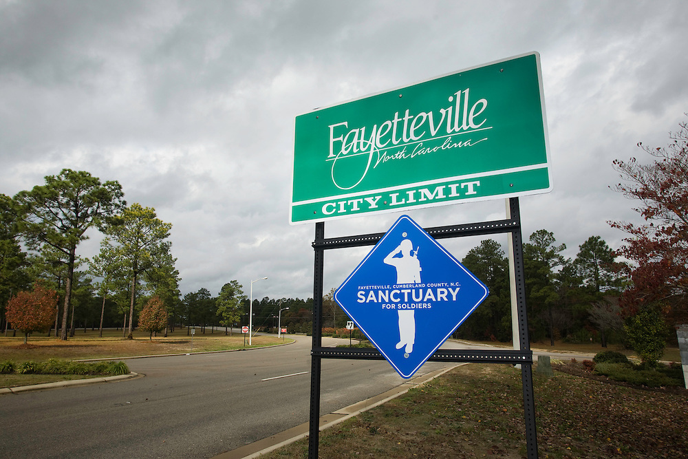 A sign declaring Fayetteville, NC, a sanctuary for soldiers is posted outside of the city limits, Sat., Nov. 15, 2008. .